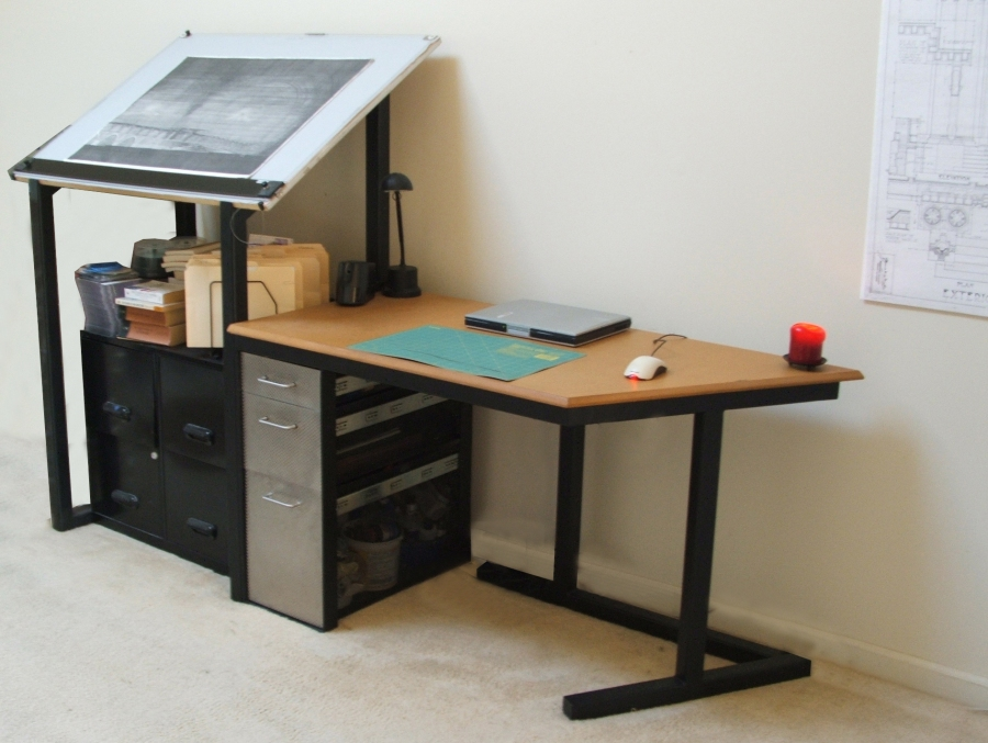My desk. Steel frame, rigidized stainless steel + perforated drawers, MDF top.