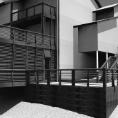 black and white rendering of a new patio added to tie the composition together